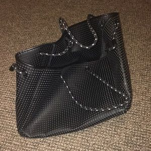 Black and white perforated travel or beach bag